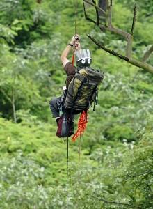 Shane McPherson climbing to an eagles nest